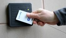 Employee swiping passcard to enter